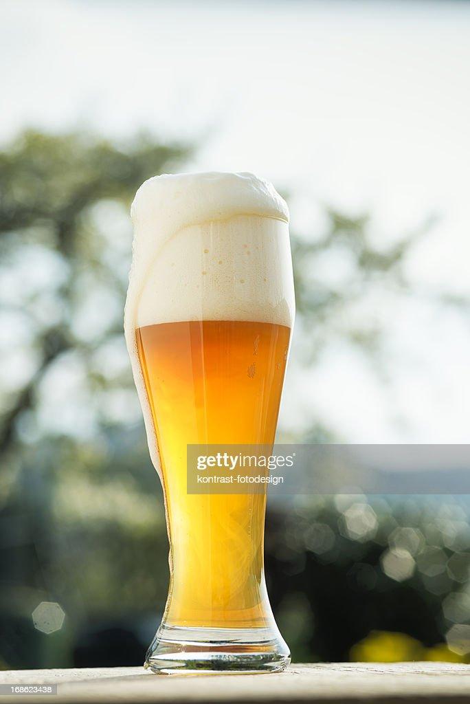 Glass of wheat beer in a Biergarden Weizenbier Hefeweizen