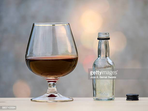 Glass of whiskey and bottle mini bar with natural light