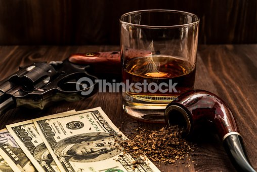 Glass Of Whiskey And Revolver With A Money And Tobacco Stock Photo