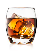 Glass of whiskey on the rocks isolated on white background and with clipping path