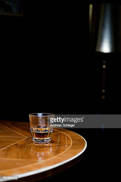 A glass of whiskey on a table