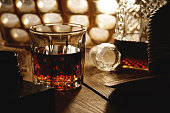 Glass of whiskey on a old wooden table