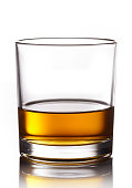 Glass of whiskey isolated on white background