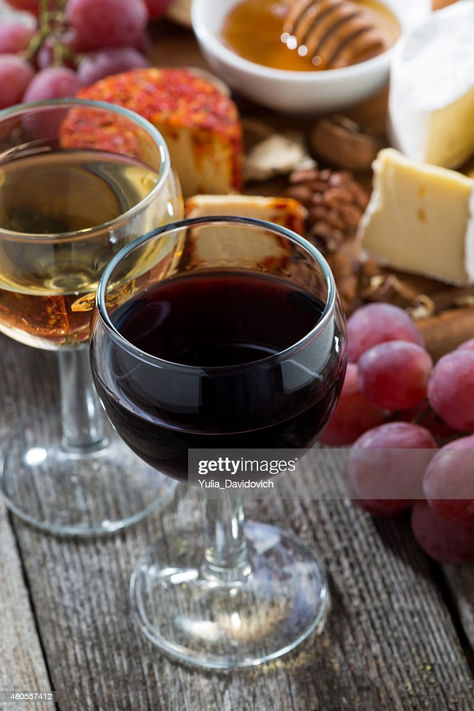 glass of white and red wines, appetizers on wooden table : Stock Photo