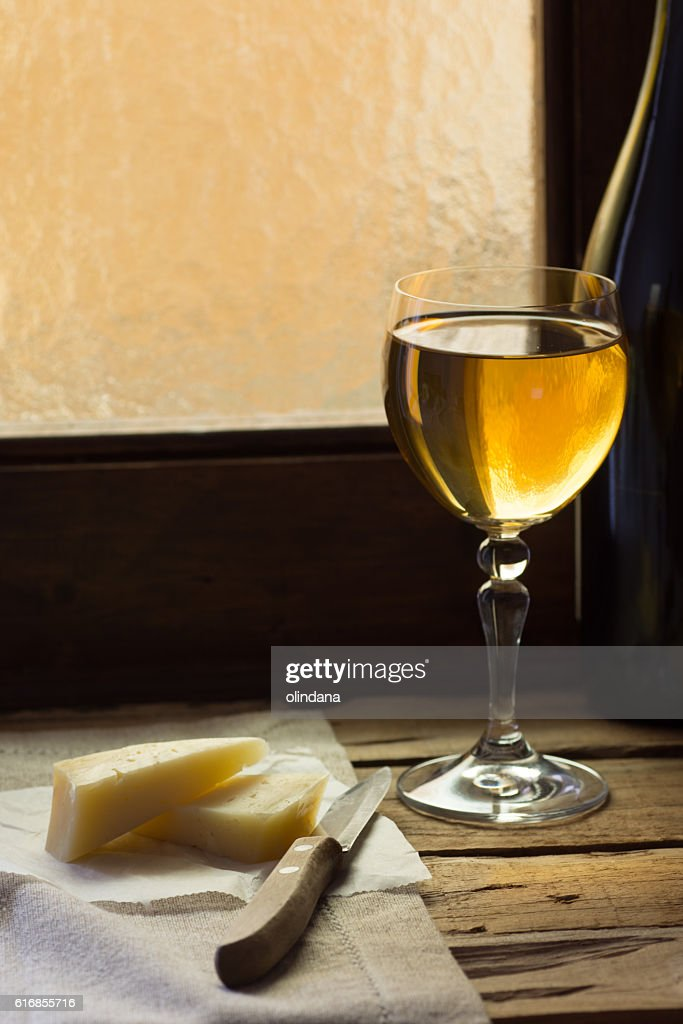 Glass of white wine with cheese : Stock Photo