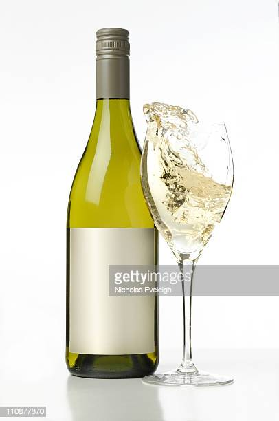 A glass of wine and a bottle