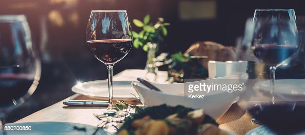 Glass of wine at dining table : Foto de stock