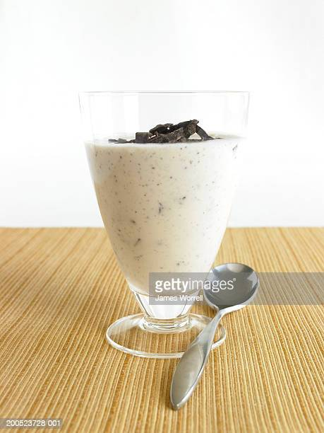 Glass of yoghurt smoothie with spoon