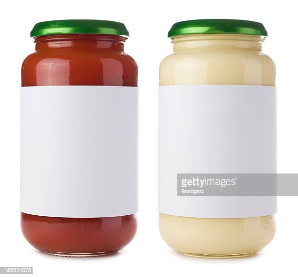 Glass pasta sauce jars on a white background