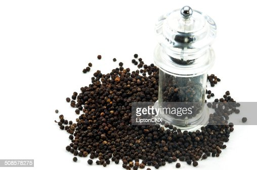 Glass pepper Grinder and peppercorn : Stock Photo