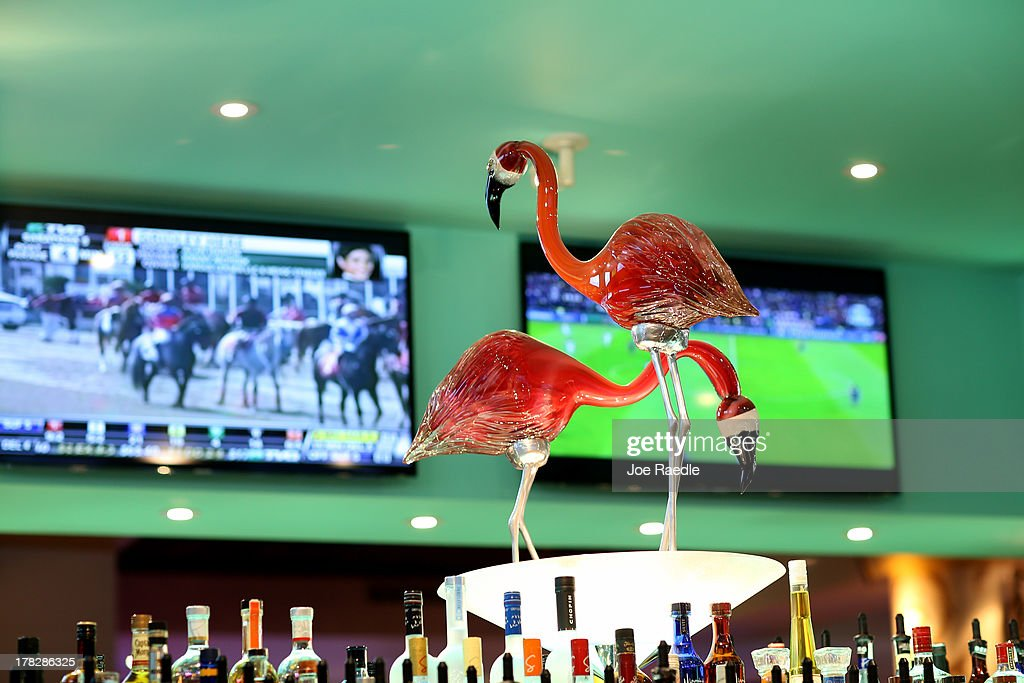 Glass pink flamingos are seen above the bar in the casino that will hold its grand opening on Friday located in the Hialeah Park Race Track which first opened in 1925 on August 28, 2013 in Hialeah, Florida. The new casino is located in the same complex as the race track which in its heyday was known as the 'the worlds most beautiful race course.'