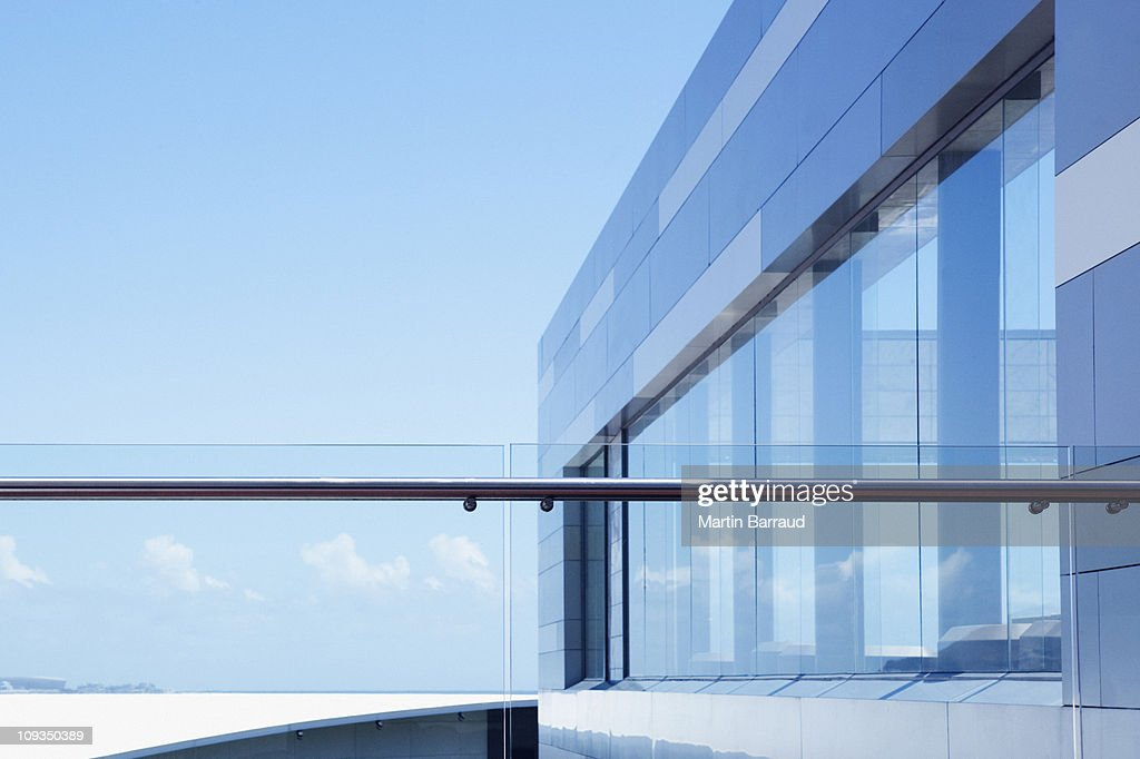 Glass railing on modern building balcony stock photo for Building balcony