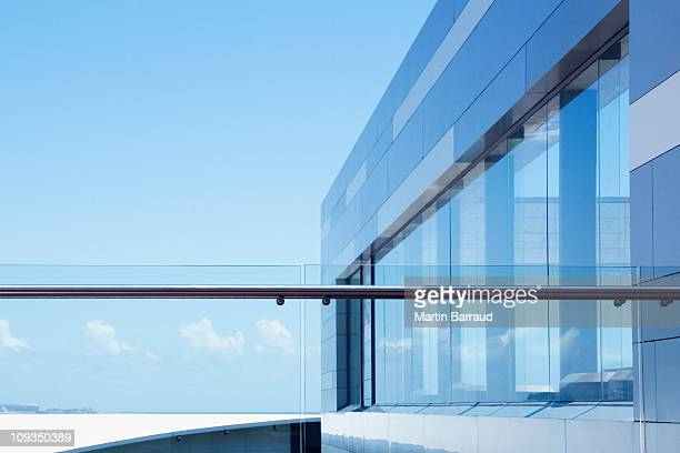 Glass railing on modern building balcony
