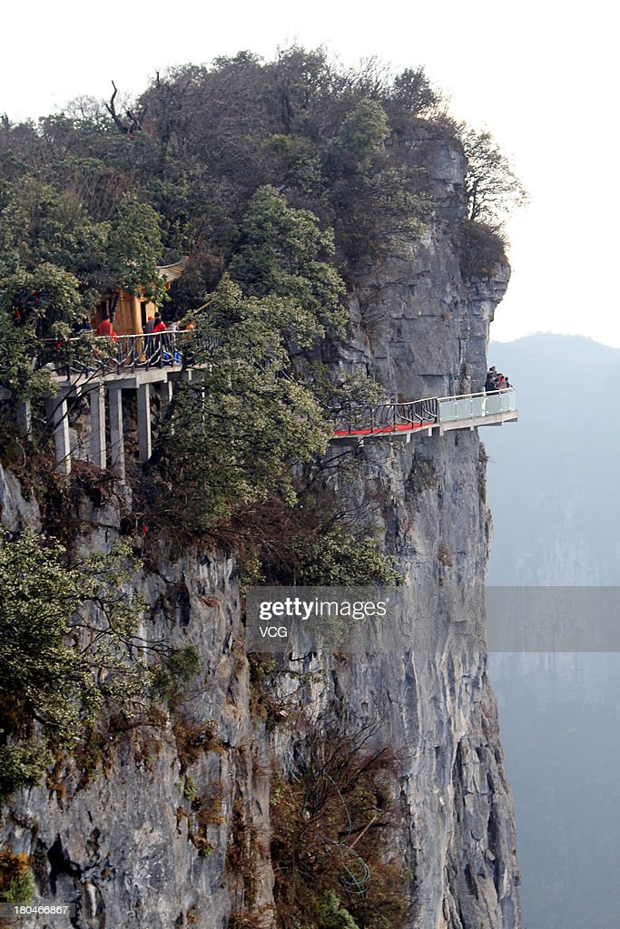 A glass road alongside a cliff is seen on Tianmen Mountain on November 9, 2011 in Zhangjiajie, Hunan Province of China. The oriental 'Skywalk', 1430m above sea level and is 60 meters long. It was built along west cliff at the Yunmeng Fairy Summit, the summit of Tianmen Mountain and Zhang Jiajie. In order to keep the glass road clean, tourists are to put on shoe covers before passing.