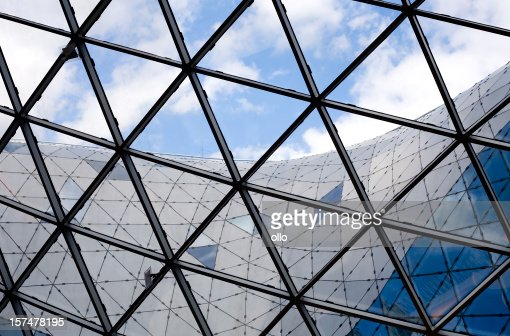 Glass roof construction, cloudy sky