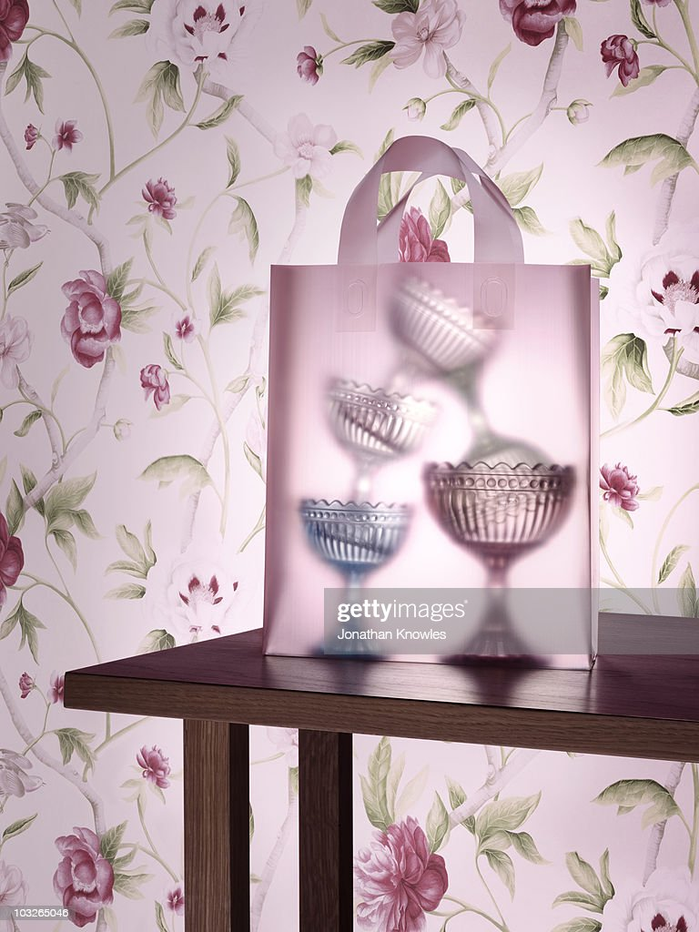 Glass serving dishes in a transparent shopping bag : Stock Photo
