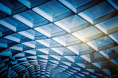 glass sunshade structure,blue toned image.