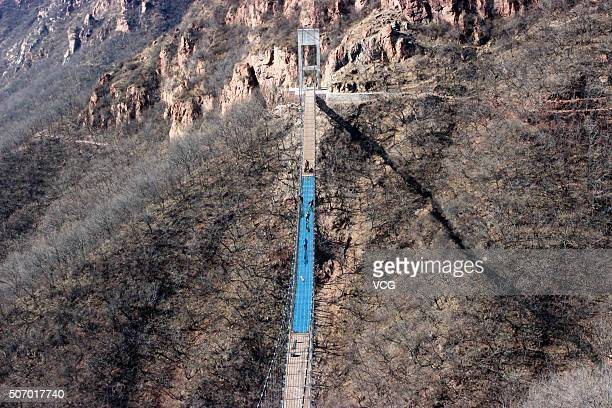 A glass suspension bridge is seen to be completed totally at Fuxishan Tourism Resort on January 26 2016 in Zhengzhou Henan Province of China The...