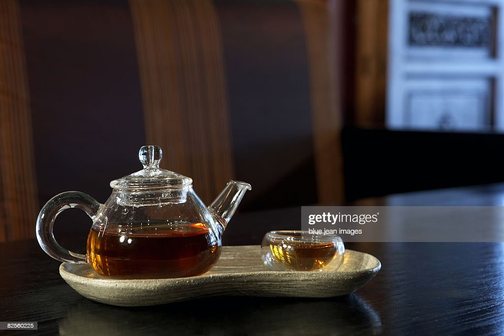 Glass tea set sitting on a table in a traditional Chinese tea house. : Stock Photo