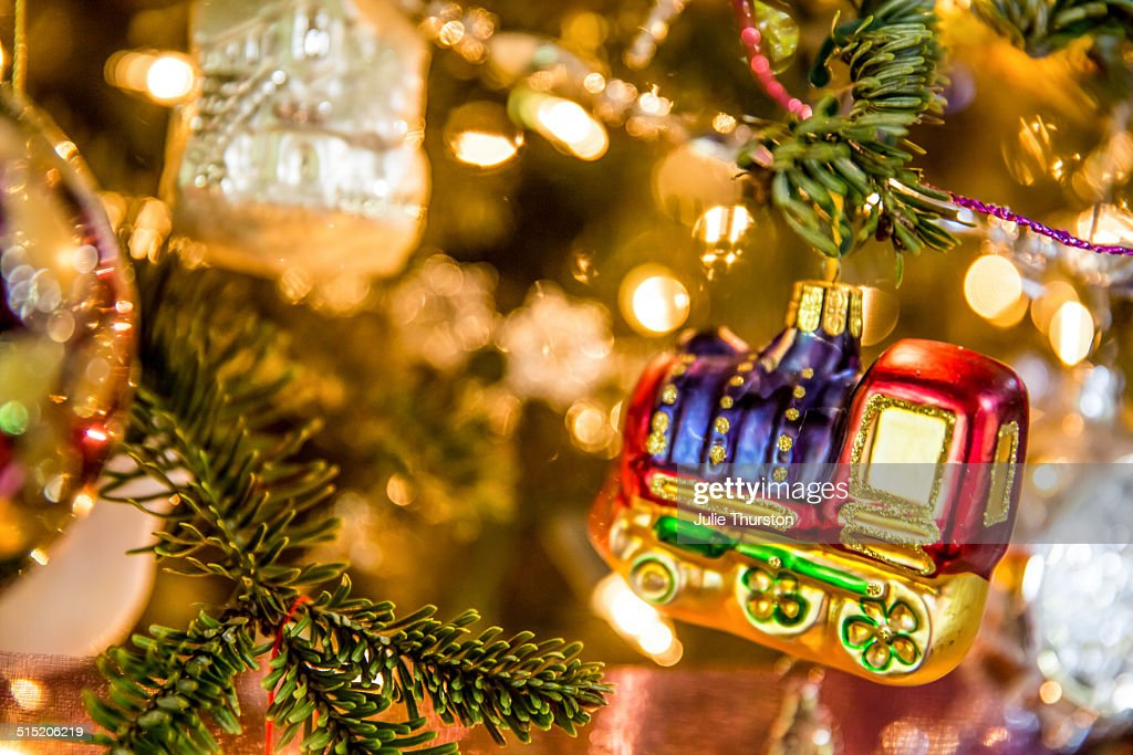 glass train ornament in the lighted christmas tree stock photo - Train For Christmas Tree