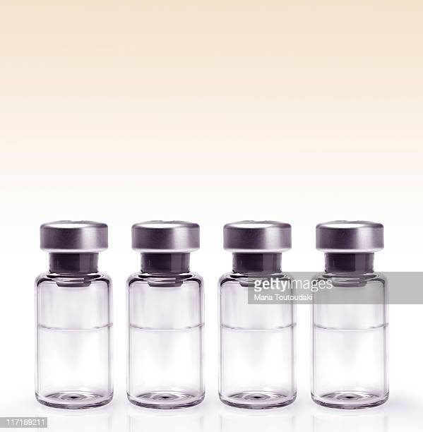 Glass vials in a row