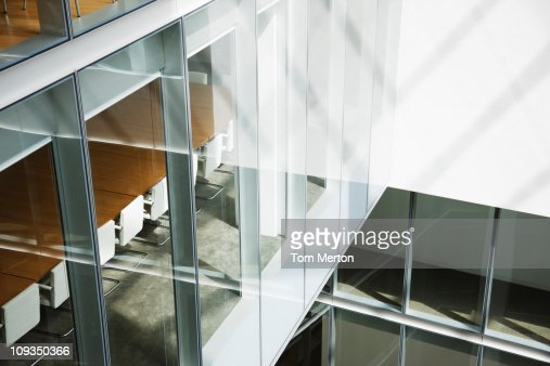 Glass walls in atrium of office building