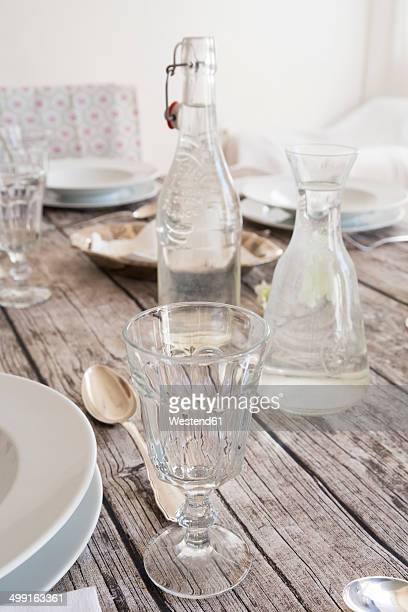 Glass, water bottle and carafe on festive laid table