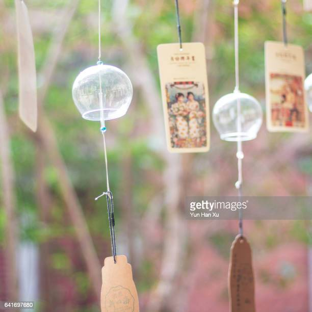Glass Wind Chimes Hanging on Window