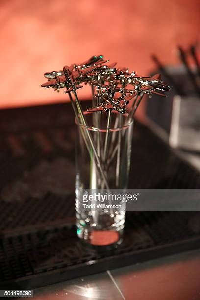 A glass with airplane swizzle sticks is displayed at the FOX Golden Globe Awards Awards Party 2016 sponsored by American Airlines at The Beverly...