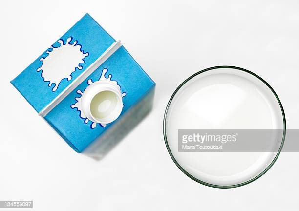 Glass with milk and carton