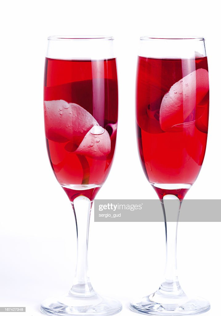 glass with red wine and an orchid : Stock Photo