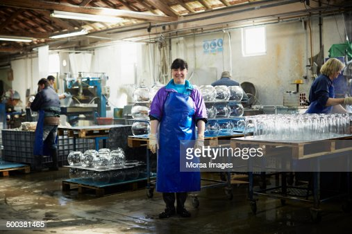 Glass worker at cutting station in factory
