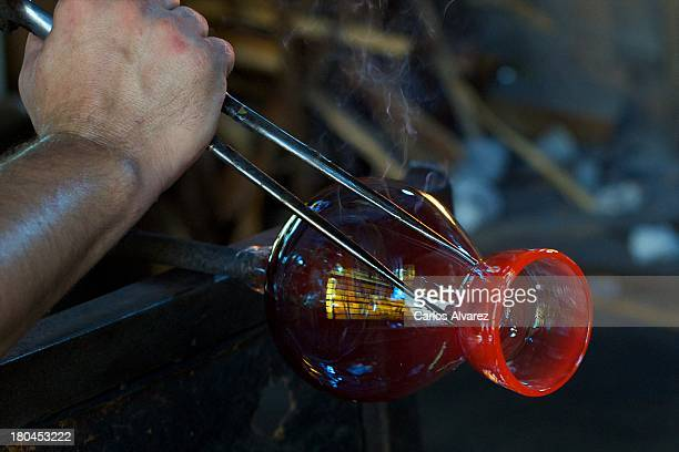 A glassblower works on a creation at the Gordiola Glass Factory on August 14 2013 in Algaida Palma de Mallorca Spain The Gordiola family have created...