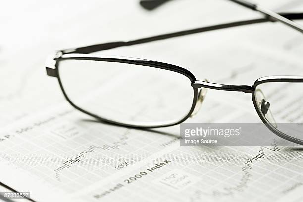 Glasses and a newspaper