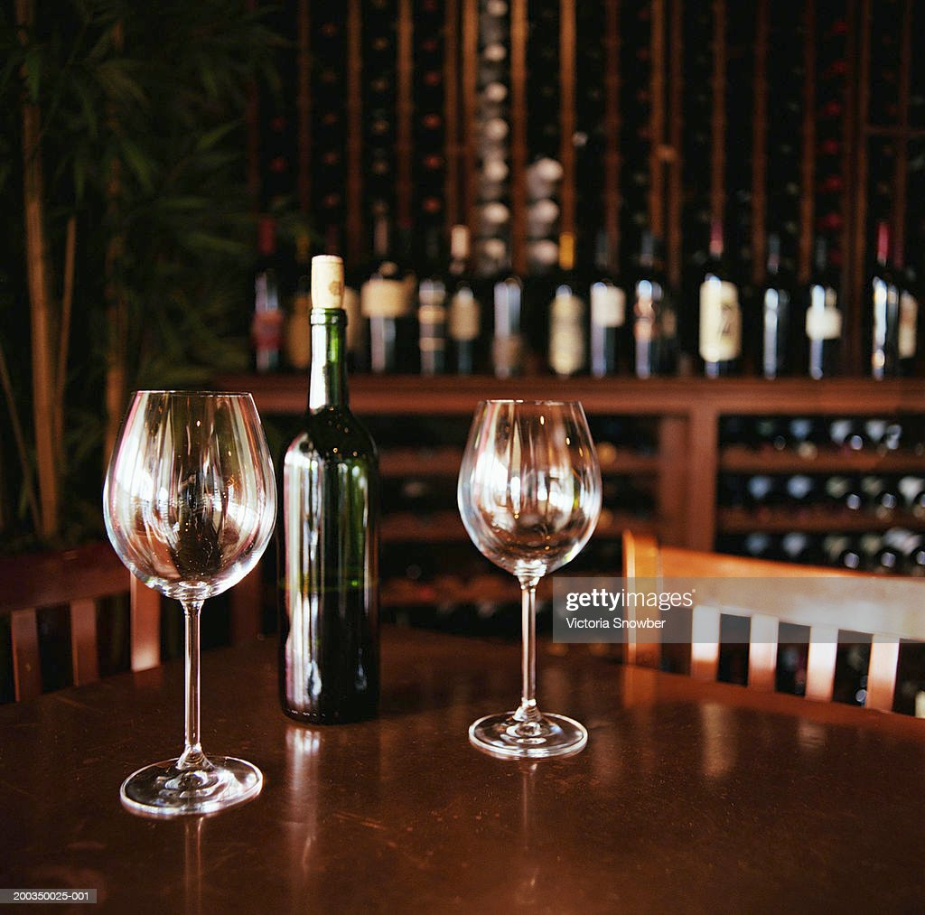 glasses and bottle of wine on table in wine bar stock photo getty images. Black Bedroom Furniture Sets. Home Design Ideas