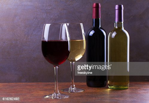 Glasses and bottles of red and white wine : Stock Photo