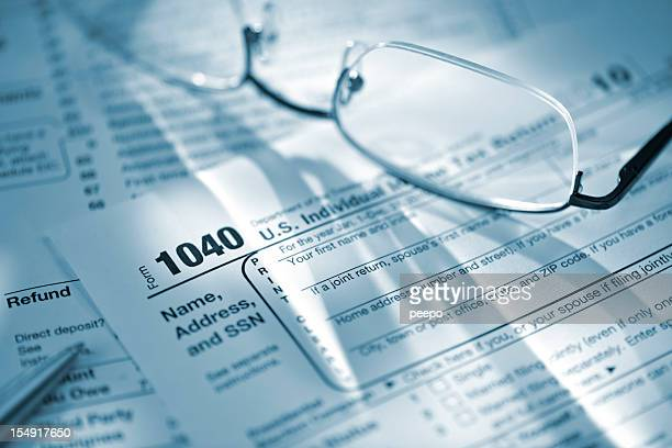 glasses and pen on US tax return form