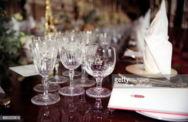 Glasses bearing the royal insignia on the banquet table in St Georges' Hall at Windsor Castle for the State Banquet hosted by the Queen and Duke of...