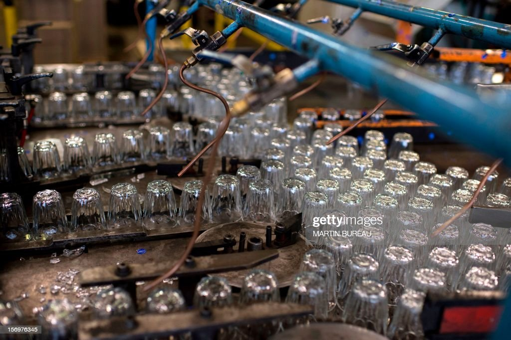 Glasses manufactured by glassware Duralex are seen on a production line, on November 26, 2012 at the Duralex factory in La Chapelle-Saint-Mesmin. AFP PHOTO MARTIN BUREAU