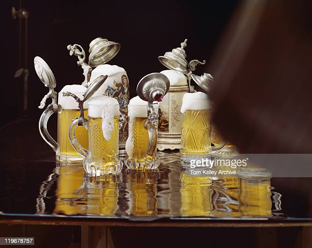 Glasses of beer with froth, close-up