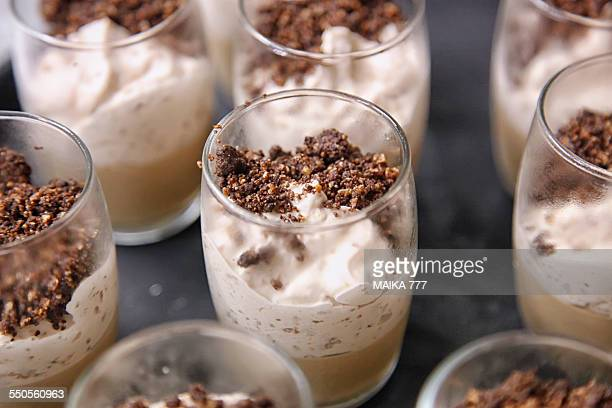 Glasses of caramel ice cream with nuts crushed