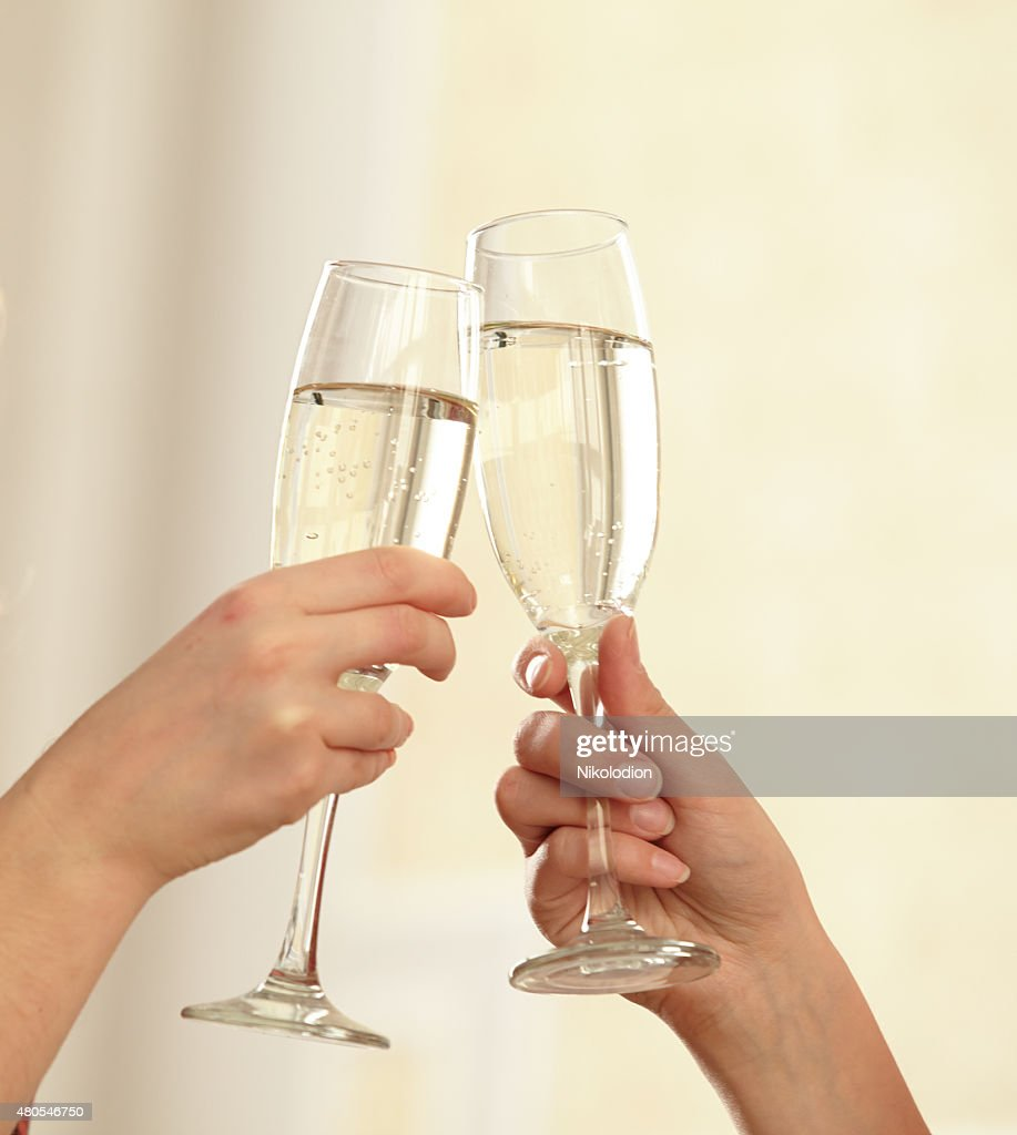 Glasses of champagne in female hands on a party : Stock Photo