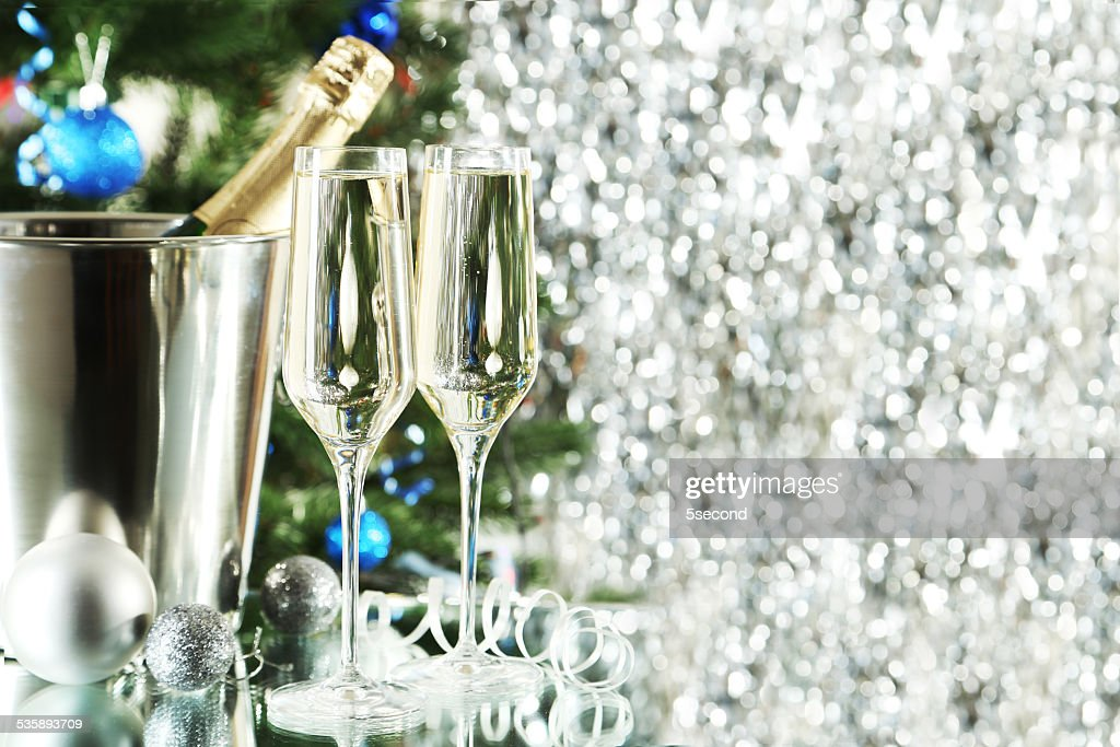 Glasses of champagne with bottle in a bucket on background : Bildbanksbilder