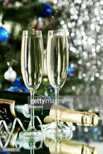 Glasses of champagne with bottle on a lights background : Stock Photo