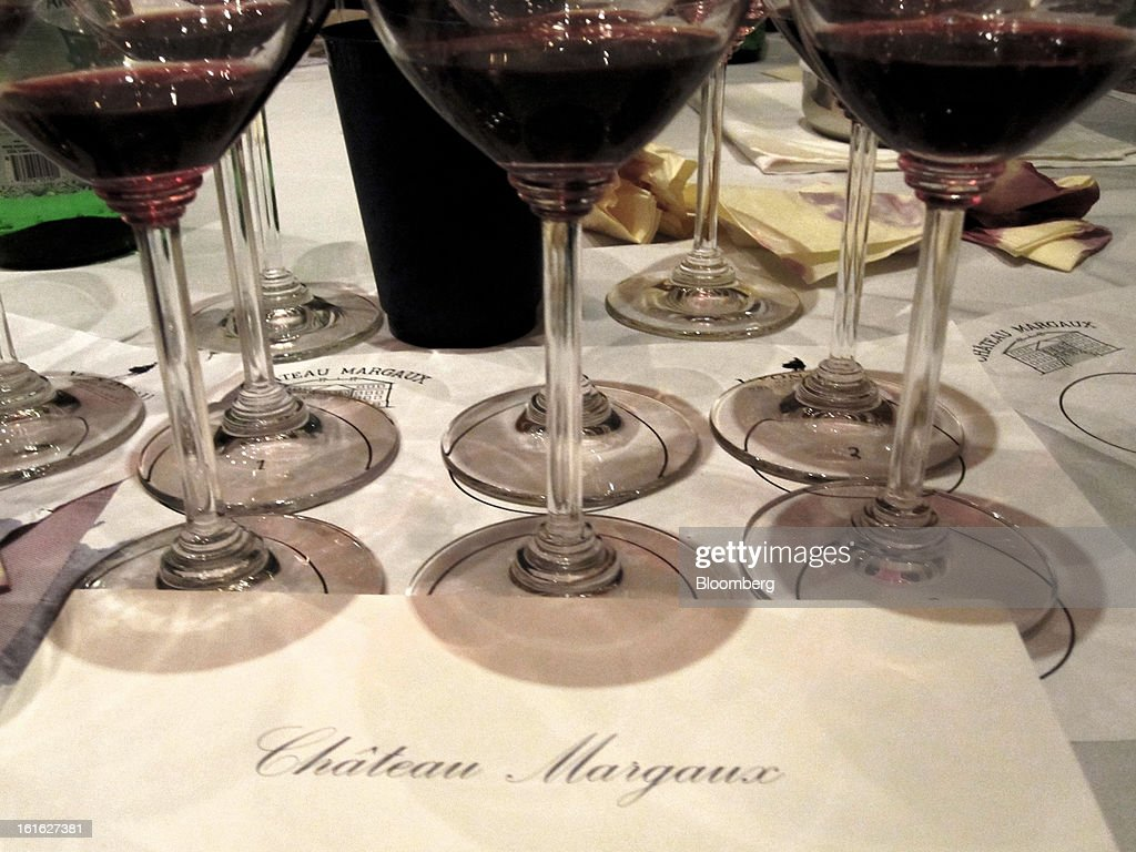 Glasses of Chateau Margaux Bordeaux wine stand on a table during a tasting event at Corkbuzz Wine Studio in New York, U.S., on Friday, Feb. 1, 2013. The lineup is a comparison of Chateau Margaux's wines made from grapes farmed conventionally, organically, and bio-dynamically in two vintages. Photographer: Elin McCoy/Bloomberg via Getty Images