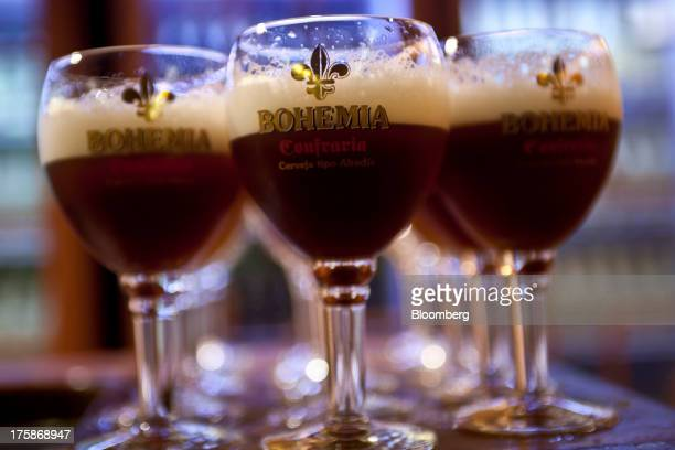 Glasses of Cia de Bebidas das Americas Bohemia brand beer are arranged for a photograph at a restored Bohemia brewery in Petropolis Brazil Sunday Aug...
