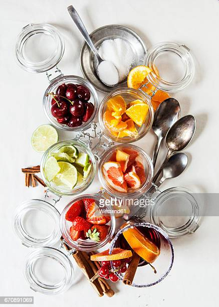 Glasses of different fruits and a glass of Sangria