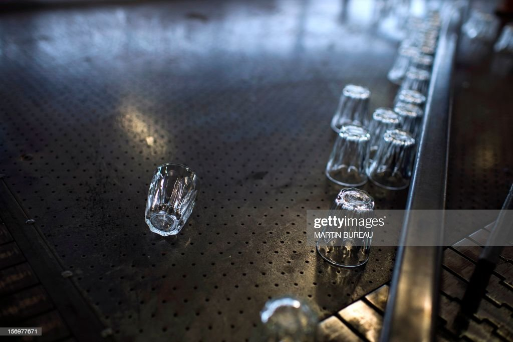 Glasses of French manufacturer of glassware Duralex are seen on a production line, on November 26, 2012 at the factory in La Chapelle-Saint-Mesmin. AFP PHOTO MARTIN BUREAU
