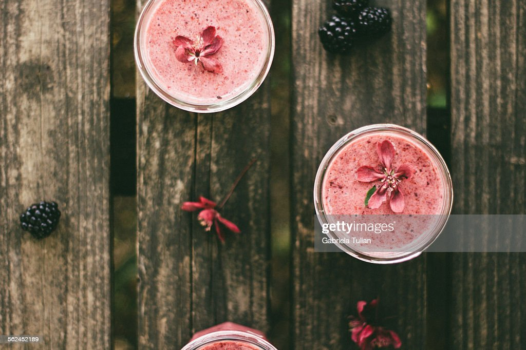 Glasses of fresh berries smoothies