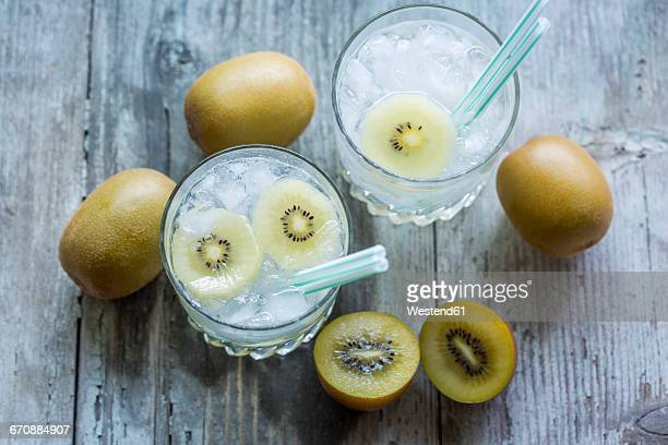 Glasses of infused water with kiwi and ice cubes